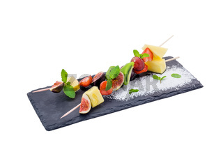 Fruits pieces mix on skewer. Isolated.