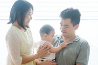 Asian parents and baby son