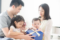 Happy Asian Family and present