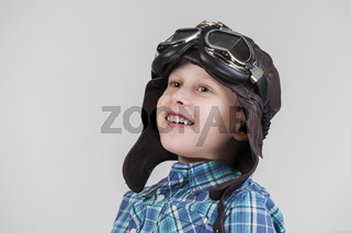 Boy with leather cap looking upwards