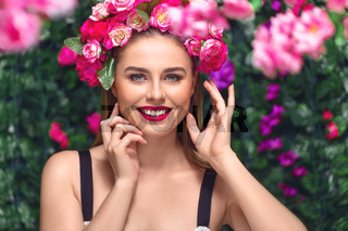 Beautiful woman with flowers wreath