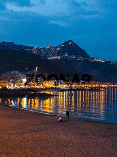 urban beach in Giardini Naxos town in summer night
