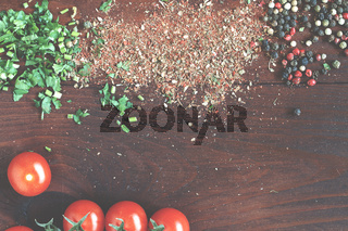 Food background. Spices, coriander, curry, cherry tomatoes, chilli pepper,