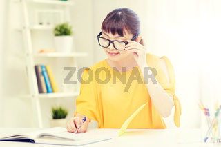 happy asian young woman student learning at home