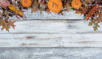 Autumn decorations on rustic white wood in top arch border