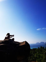 Silhouette couple sitting on the top of mountain