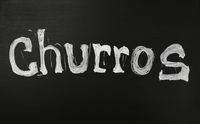 White chalk CHURROS word over black chalkboard