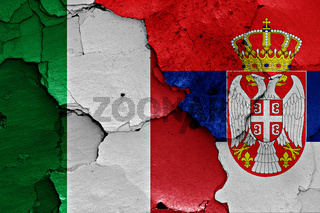 flags of Italy and Serbia painted on cracked wall