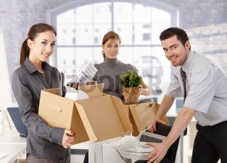 Young office workers moving office