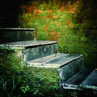 Weathered stairs of abandoned tropical house