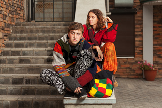 Young fashion hippie couple on the steps