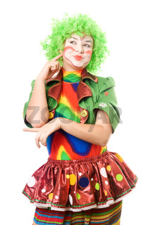 Portrait of pensive female clown. Isolated on white background