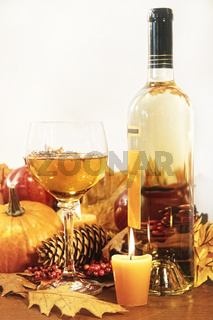 Festive decorations with wine and candles for Thanksgiving