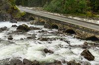 Old stone bridge. Road crossing river. Latefoss, Norway