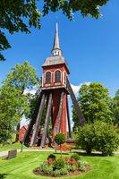 Wooden belfry in a church garden