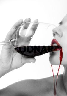 portrait of brunette girl drinking red wine