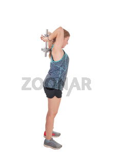 Young woman lifting dumbbell's over her head