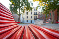 Venice from a red bench