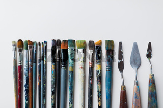 palette knives or painting spatulas and brushes