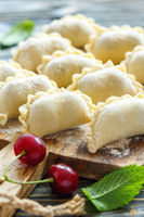 Delicious dumplings with cherries for cooking.