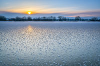 winter sunset over frozen lake in Colorado