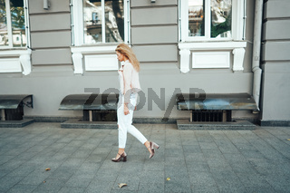 Girl is posing on the city street