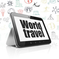 Travel concept: Tablet Computer with World Travel on display