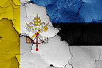 flag of Vatican and Estonia painted on cracked wall