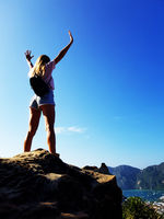 Silhouette woman standing on the top of mountain