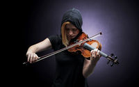 Violinst playing on instrument with empathy