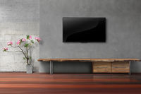 Living room led tv on concrete wall with empty wooden stand