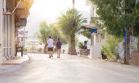 young couple is walking through a tourist resort