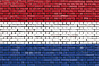 flag of Netherlands painted on brick wall