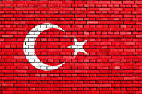 flag of Turkey painted on brick wall