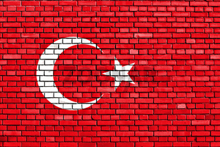 flag of Turkey painted on brick wall