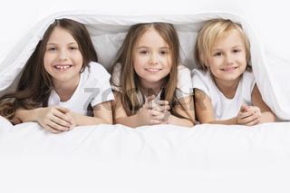 Children under blanket