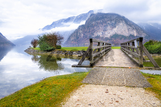 Bridge over lake and Austrian Alps