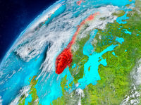 Space view of Norway in red