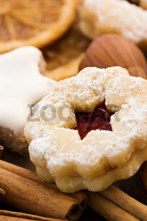Christmas cookies collection with decoration as closeup on wood.