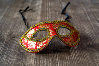 Carnival mask on the wooden table