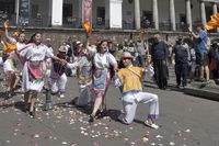 People in traditional Ecuadorean dresses dance as part of a parade through the Independence Square (Plaza Grande), Quito, Ecuador
