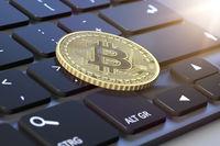 bitcoin coin on a keyboard