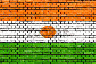 flag of Niger painted on brick wall