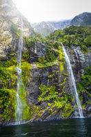 Waterfall in Milford Sound lake, New Zealand