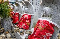Jizo statues in Arashiyama temple, Kyoto, Japan