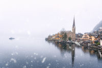 First snow over lake and village