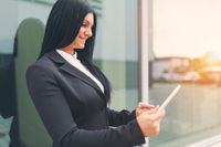 Young successful business woman working with tablet in an urban setting