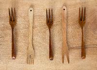 Wooden forks on wooden background