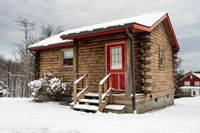 Small one roomed log cabin in snow in winter