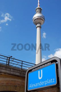 berlin television tower and metro sign